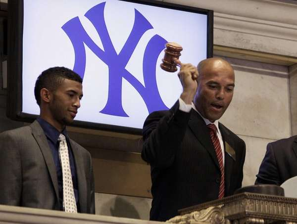 New York Yankees pitcher Mariano Rivera, right, accompanied