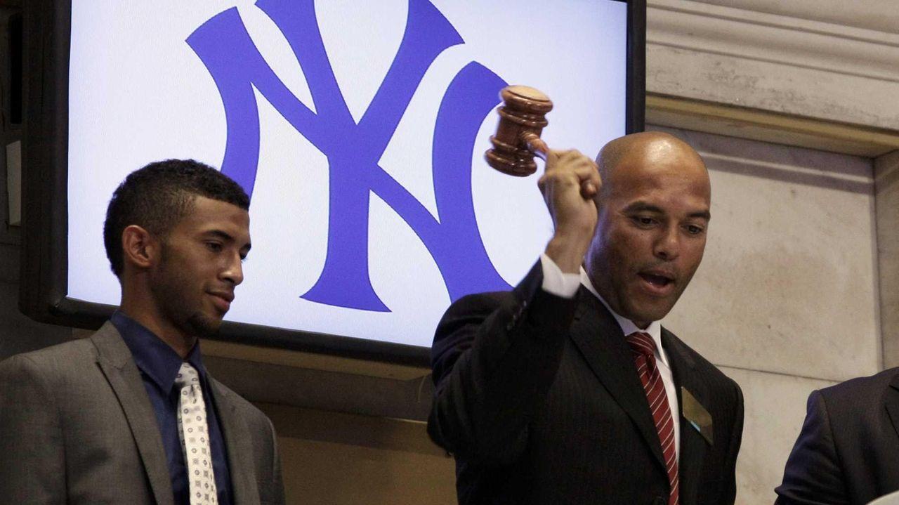New York Yankees pitcher Mariano Rivera, right, accompanied