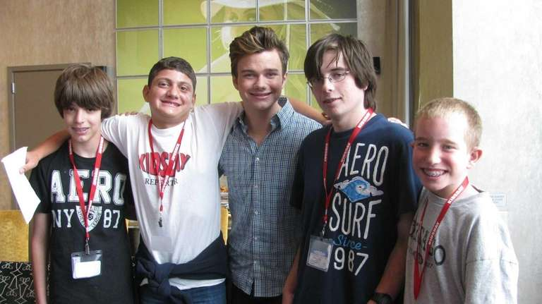 Author and actor Chris Colfer (c) with Kidsday