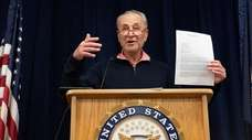 Sen. Charles Schumer (D-N.Y.) holds a letter addressed