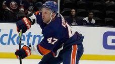 Islanders right wing Leo Komarov releases a shot