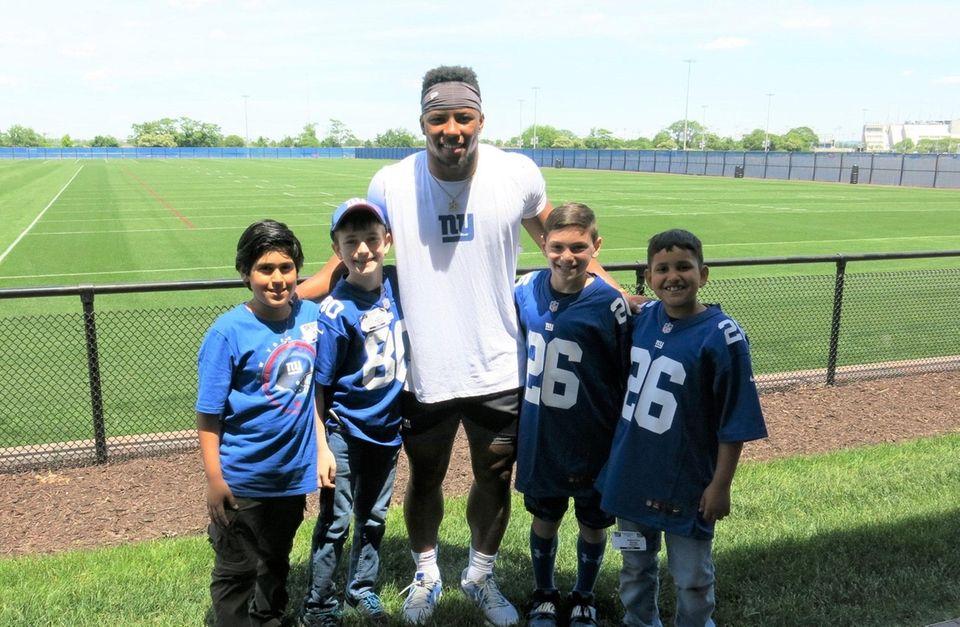 Giants running back Saquon Barkley with Kidsday reporters