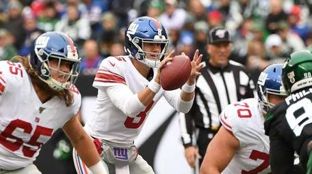 The football slips from the hands of Giants