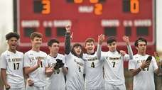 St. Anthony's boys soccer teammates salute their friends
