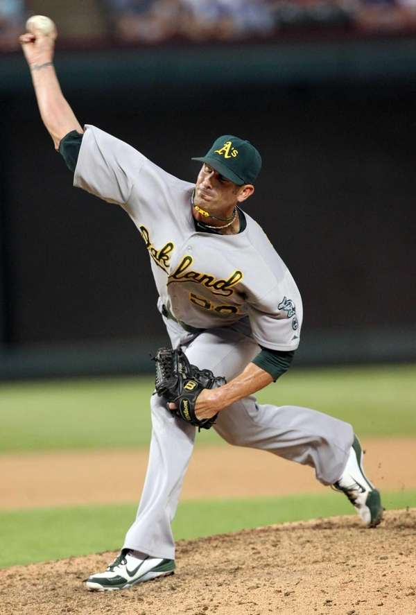 Grant Balfour of the Oakland Athletics pitches against