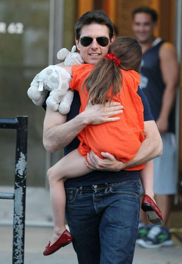 Tom Cruise and daughter Suri Cruise leaving Chelsea
