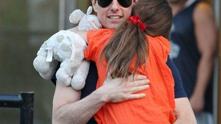 Tom Cruise and daughter Suri Cruise leaving Chelsea