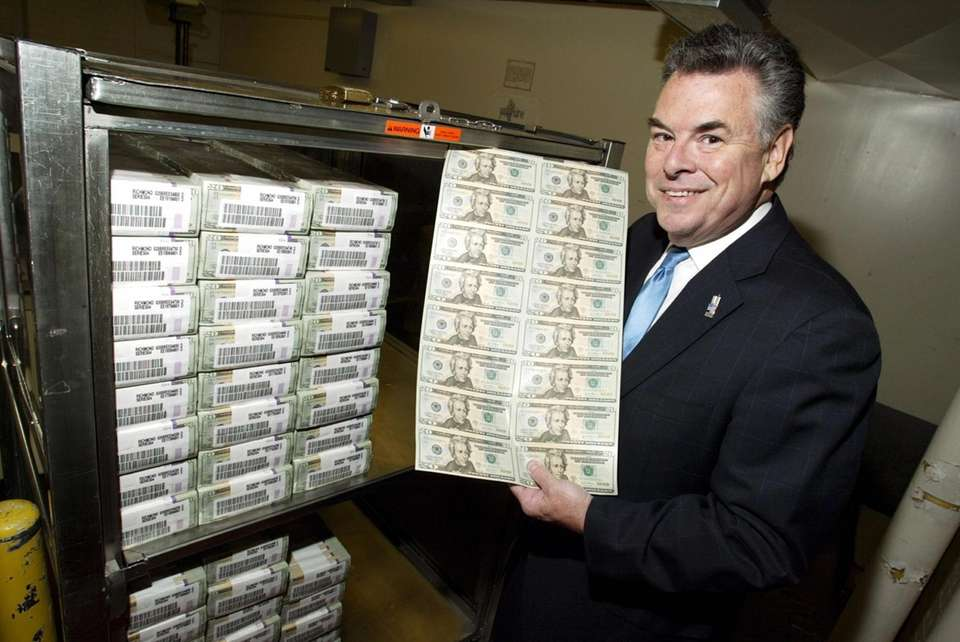 Congressman Peter King poses with a sheet of
