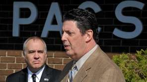PACS Industries CEO Bruce Dalis, right, with Comptroller