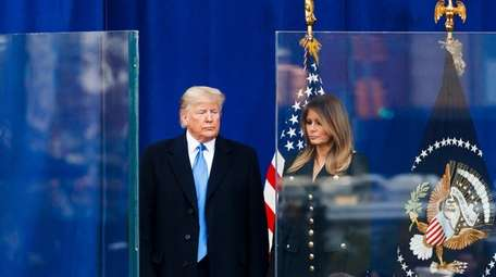 President Trump and First Lady Melania Trump stand
