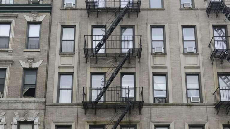 Exterior of 142 West 109th Street (center with