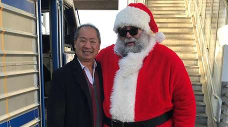 LIRR president Phil Eng with Santa during the