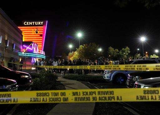 People gather outside the Century 16 movie theater