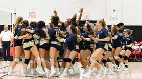 The Bayport-Blue Point girls react to their win