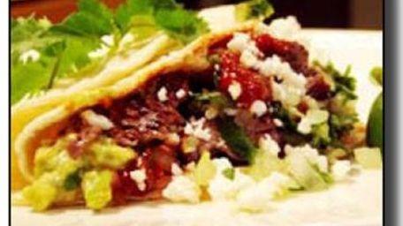 Tacqueria-style Carne Asada Tacos courtesy of AllRecipes.com