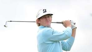 Brandt Snedeker of the United States hits his