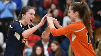 Ryan Tracy of Manhasset, congratulates Ava Paulucci after