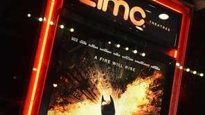 "A poster for ""The Dark Knight Rises"" in"