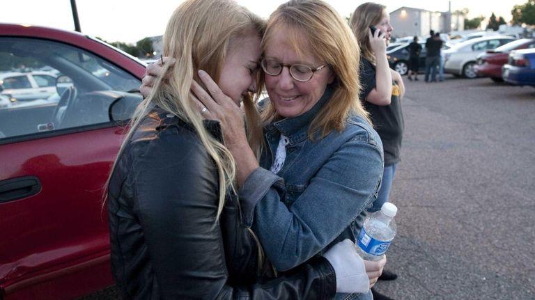 Emma Goos, 19, hugs her mother, Judy Goos,