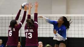 Ravae McCleary of Hauppauge tries to get her