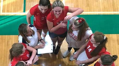 South Side varsity girls volleyball teammates gather in