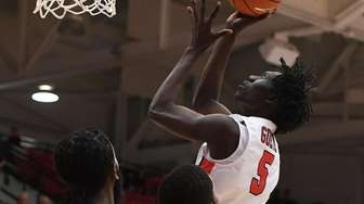 Stony Brook forward Mouhamadou Gueye puts up a