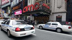 Police officers are seen outside a movie theater