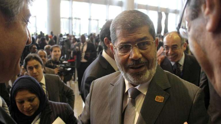 Egypt's newly elected President Mohammed Morsi, center, speaks