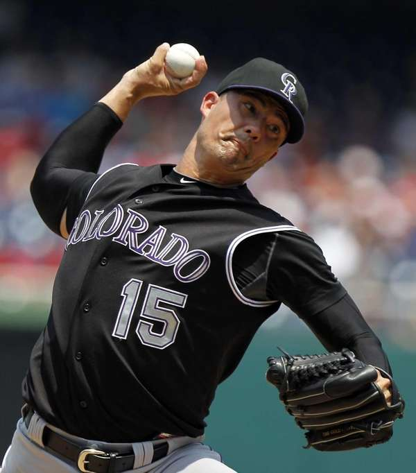 Colorado Rockies starting pitcher Jeremy Guthrie throws during