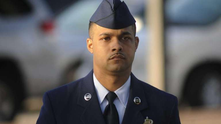 Air Force Staff Sgt. Luis Walker arrives for