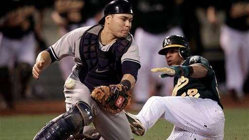 Yankees catcher Russell Martin, left, cant make the