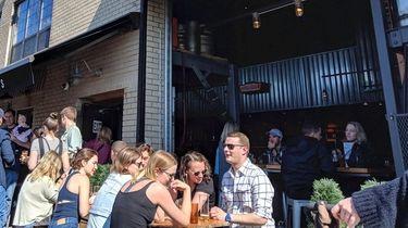 People hanging at SingleCut Beersmiths in Astoria, Queens