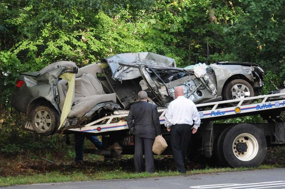 Detectives inspect the Hyundai Sonata that hit trees