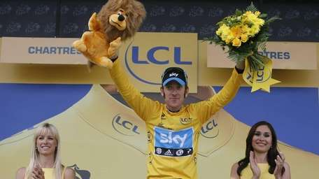 Bradley Wiggins of Britain, wearing the overall leader's