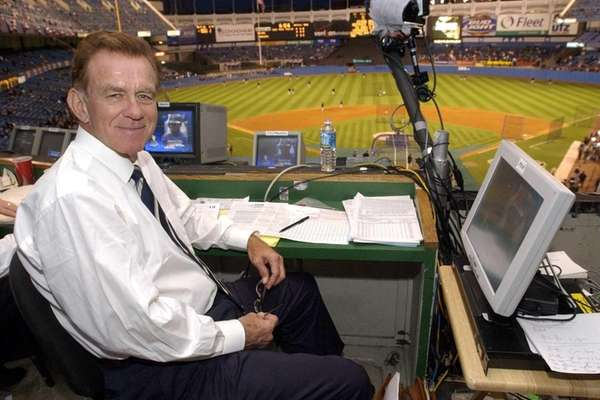 Baseball announcer Tim McCarver poses in the press