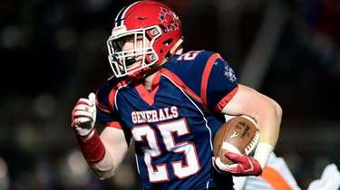 Hugh Kelleher of MacArthur runs the ball against