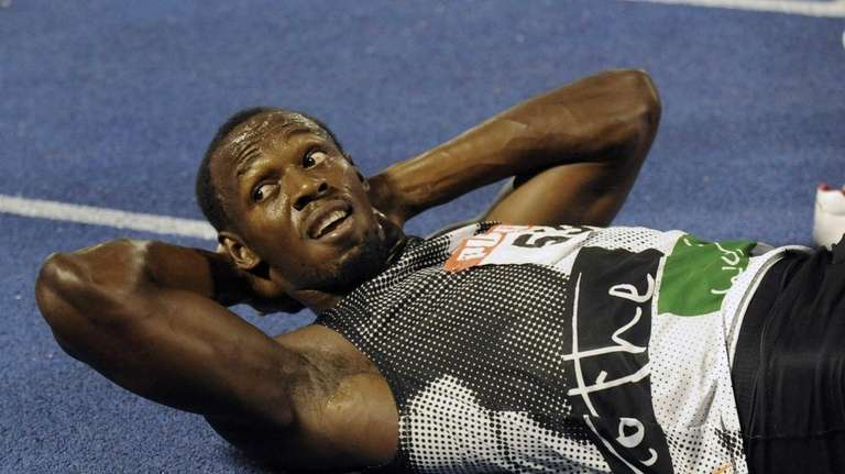 World-record holder Usain Bolt looks at the crowd