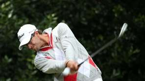Adam Scott of Australia hits his tee shot
