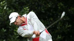 Adam Scott of Australia hits his tee shot