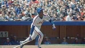 Darryl Strawberry lays down his bat at the