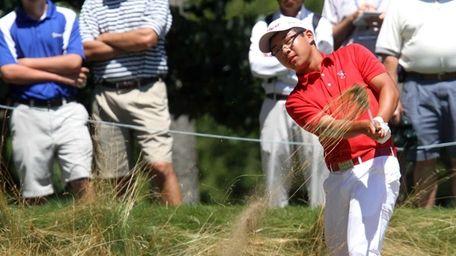 Jim Liu misses the ball as he tries
