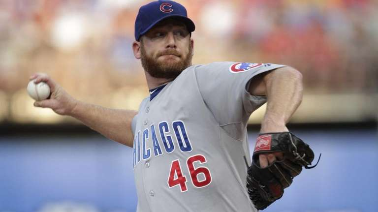 Chicago Cubs starting pitcher Ryan Dempster pitches during