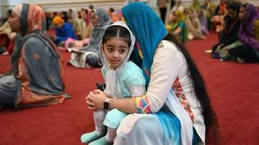 Harleen Kaur, 2, of Woodbury, and her aunt,