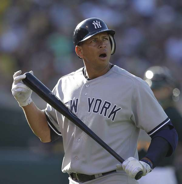 Alex Rodriguez reacts as he watches a replay