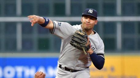 Yankees second baseman Gleyber Torres (25) throws to
