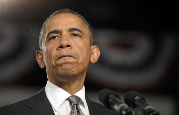 President Barack Obama pauses as he speaks about