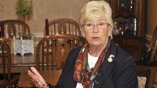 Congresswoman Carolyn McCarthy (D) talks to reporters in