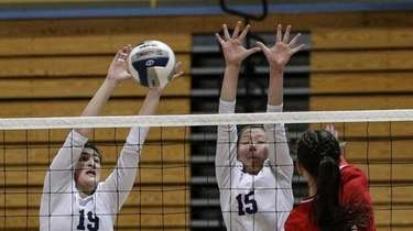Alexis Panagoulias (19) of Massapequa makes the block