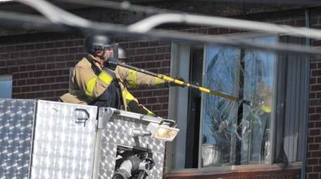 Police break the window of the apartment of