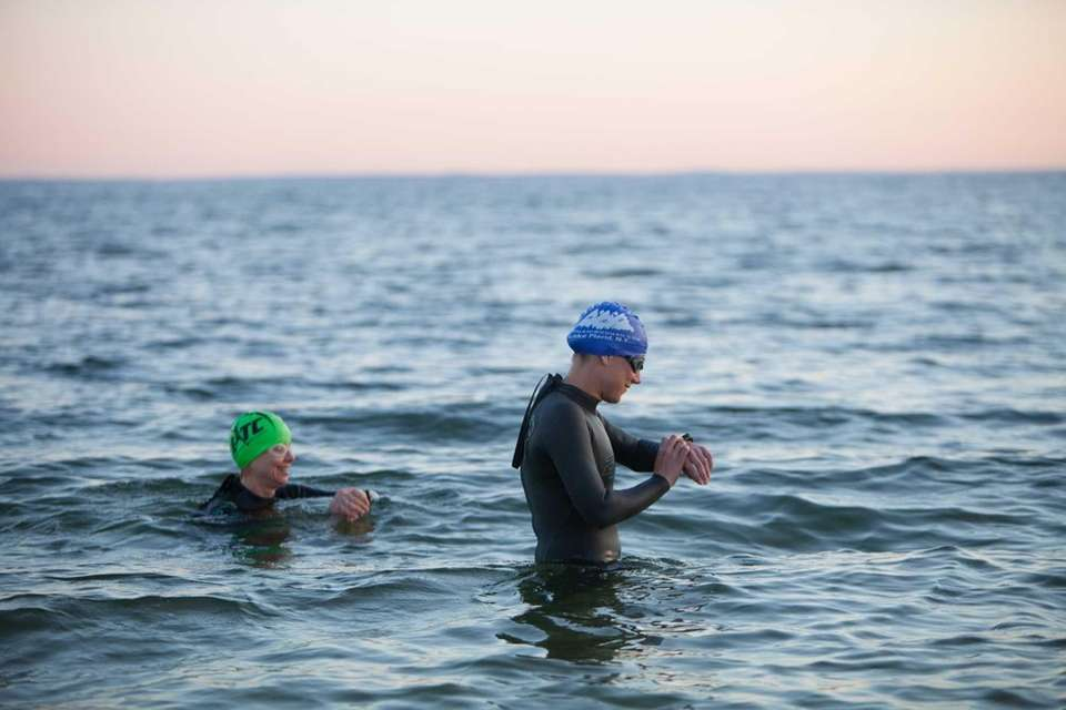 Two women go for an early morning swim